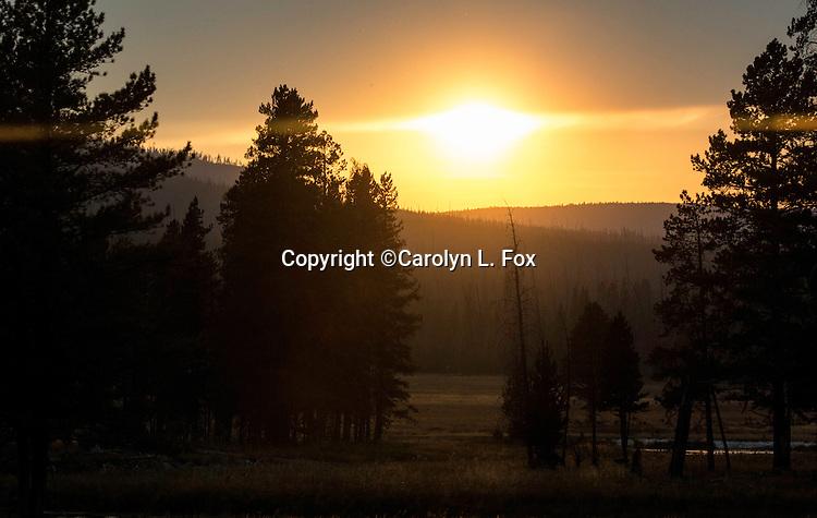 Smoke creates pretty sunsets in Yellowstone National Park.