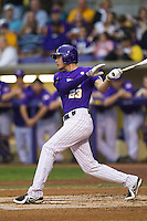 LSU Tigers second baseman JaCoby Jones #23 follows through on his swing against the Auburn Tigers in the NCAA baseball game on March 23, 2013 at Alex Box Stadium in Baton Rouge, Louisiana. LSU defeated Auburn 5-1. (Andrew Woolley/Four Seam Images).
