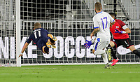 FORT LAUDERDALE, FL - DECEMBER 09: Chris Mueller #11 of the United States heads home a scoring goal during a game between El Salvador and USMNT at Inter Miami CF Stadium on December 09, 2020 in Fort Lauderdale, Florida.