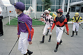 Jockeys walk to the Paddock before a race at Epsom Downs racecourse on Derby Day.