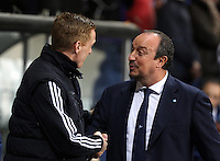 Swansea, UK. Thursday 20 February 2014<br /> Pictured L-R: Swansea manager Garry  Monk greets Napoli manager Rafa Benitez<br /> Re: UEFA Europa League, Swansea City FC v SSC Napoli at the Liberty Stadium, south Wales, UK