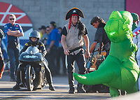 Nov 2, 2019; Las Vegas, NV, USA; NHRA pro stock motorcycle rider Jianna Salinas and crew members wear Halloween costumes during qualifying for the Dodge Nationals at The Strip at Las Vegas Motor Speedway. Mandatory Credit: Mark J. Rebilas-USA TODAY Sports