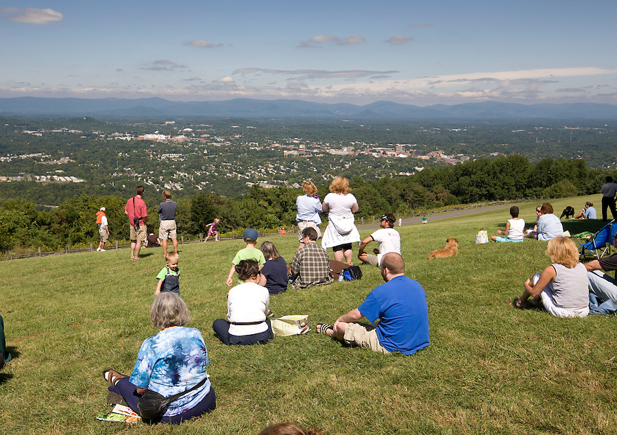 Patrons of the cultural festival enjoy the view from Mt Altos in onto the city of Charlottesville. Credit Image: © Andrew Shurtleff