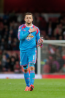 LONDON, ENGLAND - MAY 11 Lukasz Fabianski of Swansea City  walks towards the Swansea fans with his hand on the club badge after  the Premier League match between Arsenal and Swansea City at Emirates Stadium on May 11, 2015 in London, England.  (Photo by Athena Pictures/Getty Images)