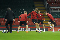 Joe Rodon (centre) battles for the ball against Connor Roberts (right) of Wales during the Wales Training Session at The Principality Stadium in Cardiff, Wales, UK. Wednesday 10 October 2018