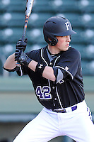 Designated hitter Jarrod Rickman (42) of the Furman University Paladins in a game against the Toledo Rockets on Sunday, February 16, 2013, at Fluor Field at the West End in Greenville, South Carolina. The game was part of the First Pitch Invitational. (Tom Priddy/Four Seam Images)