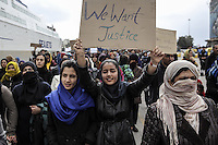 Pictured: Women with placards take part in the protest Tuesday 08 March 2016<br /> Re: Afghan migrants hold a protest at Piraeus port, near Athens, Greece.