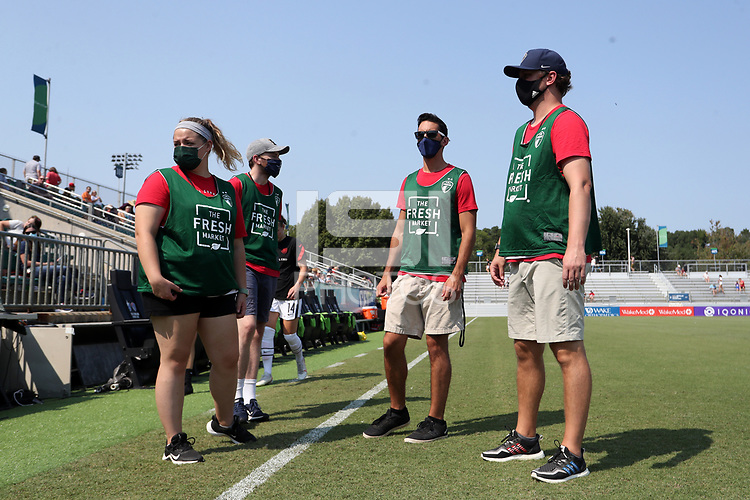 CARY, NC - SEPTEMBER 12: The ball wranglers for the game wear green The Fresh Market branded pinnies before a game between Portland Thorns FC and North Carolina Courage at Sahlen's Stadium at WakeMed Soccer Park on September 12, 2021 in Cary, North Carolina.
