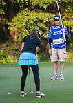 Elizabeth Elmassian of Australia walks with his caddie during the Hyundai China Ladies Open 2014 at World Cup Course in Mission Hills Shenzhen on December 13 2014, in Shenzhen, China. Photo by Xaume Olleros / Power Sport Images