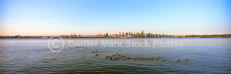 Vancouver, BC, British Columbia, Canada - City and Downtown Skyline at Dawn, Port of Vancouver Harbor / Harbour, Burrard Inlet - taken from North Vancouver - Panoramic View
