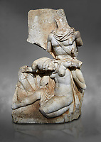 Roman Sebasteion relief sculpture of Nero conquering Armenia Aphrodisias Museum, Aphrodisias, Turkey.  Against a grey background.<br /> <br /> Nero, wearing only a cloak and sword strap, supports a slumped naked Armenia by her upper arms. She wears a soft eastern hat, and her bow and quiver are next to her. The heroic composition likens them to Achilles and the Amazon Queen Penthesilea. The inscription reads: Armenia - (Neron) Klaudios Drousos Kaisar Sebastos Germanikos.