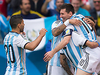 Lionel Messi of Argentina celebrates scoring a goal with team mates after making it 1-0