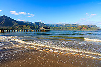 Hanalei Bay and Hanalei Pier with green mountains in the distance, Kaua'i.