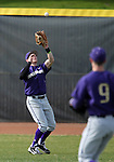 University of Washington's Jayce Ray makes a catch in  right field in a college baseball game against UC Davis, in Davis, Ca., on Saturday, Feb. 16, 2013. Davis won the opener 6-5 and dropped the second game 3-2..Photo by Cathleen Allison