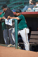 Greensboro Grasshoppers manager Miguel Perez (29) watches the action from the dugout during the game against the Hickory Crawdads at L.P. Frans Stadium on May 26, 2019 in Hickory, North Carolina. The Crawdads defeated the Grasshoppers 10-8. (Brian Westerholt/Four Seam Images)