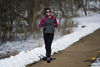 Angie Roy of Bella Vista jogs, Friday, February 19, 2021 along Slaughter Pen Trail in Bentonville. Check out nwaonline.com/210220Daily/ for today's photo gallery. <br /> (NWA Democrat-Gazette/Charlie Kaijo)