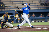 Indiana State Sycamores shortstop Clay Dungan (6) follows through on his swing against the Michigan Wolverines on April 10, 2019 in the NCAA baseball game at Ray Fisher Stadium in Ann Arbor, Michigan. Michigan defeated Indiana State 6-4. (Andrew Woolley/Four Seam Images)