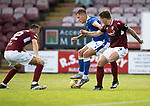 Arbroath v St Johnstone…21.07.21  Gayfield Park<br />Callum Hendry holds off Ricky Little<br />Picture by Graeme Hart.<br />Copyright Perthshire Picture Agency<br />Tel: 01738 623350  Mobile: 07990 594431