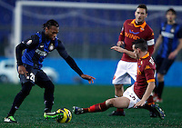 Calcio, semifinale di andata di Coppa Italia: Roma vs Inter. Roma, stadio Olimpico, 23 gennaio 2013..FC Inter midfielder Joel Obi, of Nigeria, is challenged by AS Roma midfielder Alessandro Florenzi, right, during the Italy Cup football semifinal first half match between AS Roma and FC Inter at Rome's Olympic stadium, 23 January 2013..UPDATE IMAGES PRESS/Isabella Bonotto