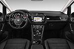 Stock photo of straight dashboard view of 2016 Volkswagen Touran Highline 5 Door Mini Mpv Dashboard
