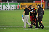 WASHINGTON, DC - AUGUST 25: Edison Flores #10 of D.C. United gets escorted from the field during a game between New England Revolution and D.C. United at Audi Field on August 25, 2020 in Washington, DC.