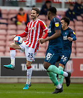 20th March 2021; Bet365 Stadium, Stoke, Staffordshire, England; English Football League Championship Football, Stoke City versus Derby County; Nick Powell of Stoke City under pressure from Matt Clarke of Derby County