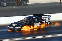Feb 8, 2015; Pomona, CA, USA; NHRA funny car driver Jeff Arend explodes a fuel tank causing a fire during the Winternationals at Auto Club Raceway at Pomona. Arend was uninjured in the explosion. Mandatory Credit: Mark J. Rebilas-