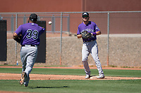 Colorado Rockies first baseman Tyler Kevin (30) prepares to catch a ball flipped by relief pitcher Rico Garcia (39) during an Extended Spring Training game against the San Diego Padres at Peoria Sports Complex on March 30, 2018 in Peoria, Arizona. (Zachary Lucy/Four Seam Images)