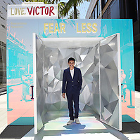 """SANTA MONICA, CA - JUNE 11: Anthony Kayvan poses for a photo at a special photo-activation in honor of Pride Month and the Season 2 premiere of the Hulu Original Series """"Love, Victor,"""" on June 11, 2021 in Santa Monica, California. (Photo by Frank Micelotta/Hulu/PictureGroup)"""