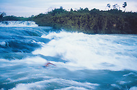 Uganda. Jinja district. Jinja. View on the Nile river.  A young man, earning less than one euro and risking his life, swims for the tourists in the running down the Bujagali Falls.  © 2004 Didier Ruef