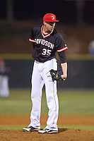 Davidson Wildcats relief pitcher Matt Saeta (35) looks to his catcher for the sign against the Wake Forest Demon Deacons at Wilson Field on March 19, 2014 in Davidson, North Carolina.  The Wildcats defeated the Demon Deacons 7-6.  (Brian Westerholt/Four Seam Images)