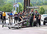 Jun 21, 2015; Bristol, TN, USA; Crew members push NHRA top fuel driver Brittany Force forward towards the water box during the Thunder Valley Nationals at Bristol Dragway. Mandatory Credit: Mark J. Rebilas-