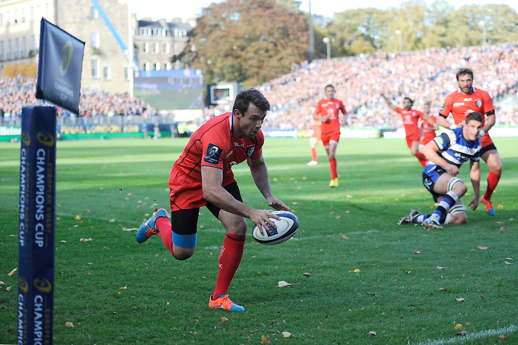 Vincent Clerc of Stade Toulousain runs in the opening try during the European Rugby Champions Cup  Round 2 match between Bath Rugby and Stade Toulousain at The Recreation Ground on Saturday 25th October 2014 (Photo by Rob Munro)