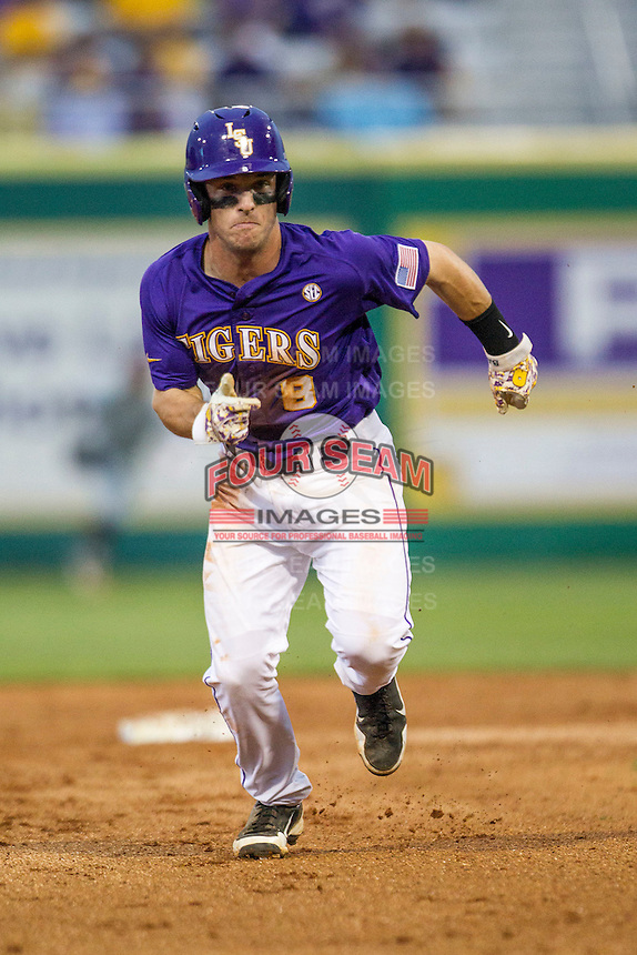 LSU Tigers shortstop Alex Bregman (8) runs to third base during a Southeastern Conference baseball game against the Texas A&M Aggies on April 24, 2015 at Alex Box Stadium in Baton Rouge, Louisiana. LSU defeated Texas A&M 9-6. (Andrew Woolley/Four Seam Images)