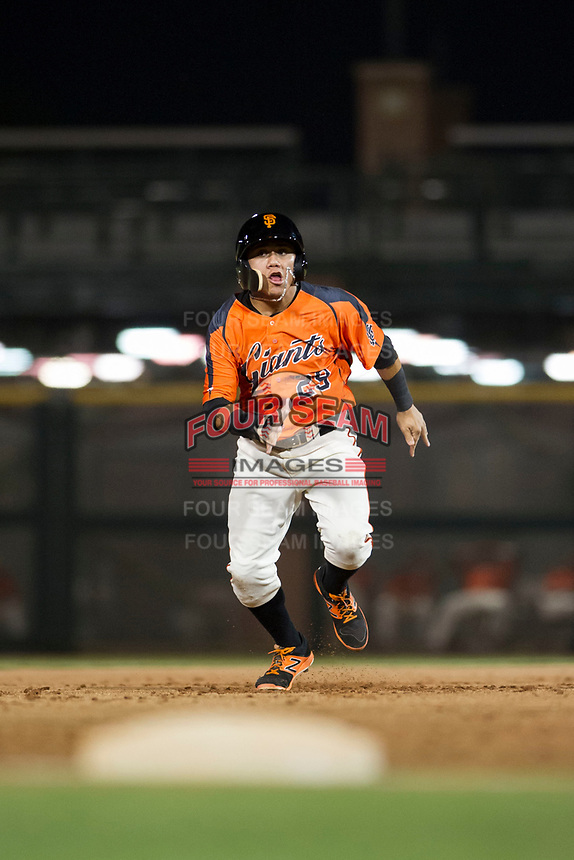 AZL Giants center fielder Ismael Munguia (29) hustles towards third base against the AZL Cubs on September 5, 2017 at Scottsdale Stadium in Scottsdale, Arizona. AZL Cubs defeated the AZL Giants 10-4 to take a 1-0 lead in the Arizona League Championship Series. (Zachary Lucy/Four Seam Images)