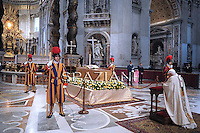 "Pope Benedict XVI kneels before the coffin of his predecessor Pope John Paul II in St. Peter's Basilica in the Vatican following his beatification. Pope Benedict XVI hailed John Paul II's ""strength of a titan"" in defending Christianity against ""a tide which appeared irreversible"" in a homily in Saint Peter's Square.May 1, 2011,SPAZIANI PHOTO/ OSSERVATORE ROMANO"