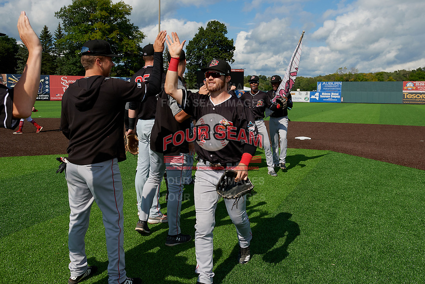 Batavia Muckdogs J.D. Orr (22) high fives teammates after clinching the Pinckney Division Title during a NY-Penn League game against the Auburn Doubledays on September 2, 2019 at Falcon Park in Auburn, New York.  Batavia defeated Auburn 7-0 to clinch the Pinckney Division Title.  (Mike Janes/Four Seam Images)