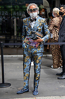 Milan,Italy - 19th june 2021 - Dolce & Gabbana fashion show for Milano fashion week Men's collection 18-22 june 2021 - man with a flower dress look and mask
