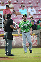 Eugene Emeralds Manager Jesus Feliciano (23) argues with home plate umpire Pete Rivera during a game against the Salem-Keizer Volcanoes at Volcanoes Stadium on July 24, 2017 in Keizer, Oregon. Eugene defeated Salem-Keizer, 7-6. (Larry Goren/Four Seam Images)