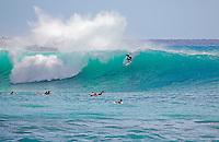 Surfing large waves at Makena, Maui, Hawaii.