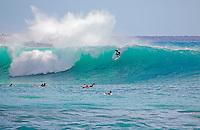 Surfing large waves at Makena, Maui, Hawaii.