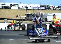 Jul. 31, 2011; Sonoma, CA, USA; NHRA top fuel dragster driver Antron Brown celebrates after winning the Fram Autolite Nationals at Infineon Raceway. Mandatory Credit: Mark J. Rebilas-