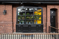 Plants stand in the window of the temporarily closed Lansdowne Pub across Lansdowne Street from Fenway Park in Boston, Massachusetts, seen here on Wed., Jan. 6, 2021. The plants appear to have been moved to the window to maximize their exposure to sunlight during the closure. A facebook post from the bar on Nov. 28, 2020, states that the Lansdowne hopes to reopen in March 2021.