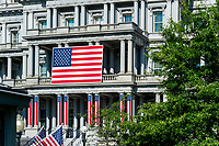 American flags are seen on the exterior of the Eisenhower Executive Office Building at the White House, Wednesday June 30, 2021, in honor of the 4th of July. (Official White House Photo by Cameron Smith)