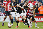Sheffield United v Port Vale<br /> 19.10.2013<br /> Sky Bet League One<br /> Picture Shaun Flannery/Trevor Smith Photography<br /> Port Vale's Chris Lines grabs the lip of United's Ryan Flynn.