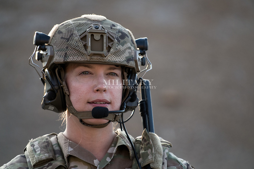 Solo protrait of a US Military woman photographed in natural light.