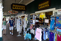 Shopping along Front street's many storefronts  in historic Lahaina town. Maui.