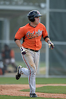 Catcher Austin Wynns (48) of the Baltimore Orioles organization during a minor league spring training game against the Minnesota Twins on March 20, 2014 at Buck O'Neil Complex in Sarasota, Florida.  (Mike Janes/Four Seam Images)