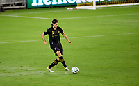 LOS ANGELES, CA - SEPTEMBER 23: Dejan Jakovic #5 of LAFC moves with the ball during a game between Vancouver Whitecaps and Los Angeles FC at Banc of California Stadium on September 23, 2020 in Los Angeles, California.
