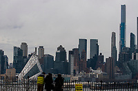 NEW JERSEY, WEEHAWKEN - FEBRUARY 28: People watch the New York skyline on February 28, 2021 as seen from Weehawken. New Jersey. New York City has seen an increase in leases signed since the 2008 financial crisis, only in Manhattan the increase was 58%, with 6,255 leases signed during the year. (Photo by Emaz/VIEWpress via Getty Images)